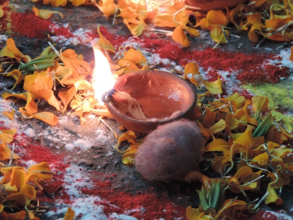 Rangolis and diyas decorate the streets during Deepawali