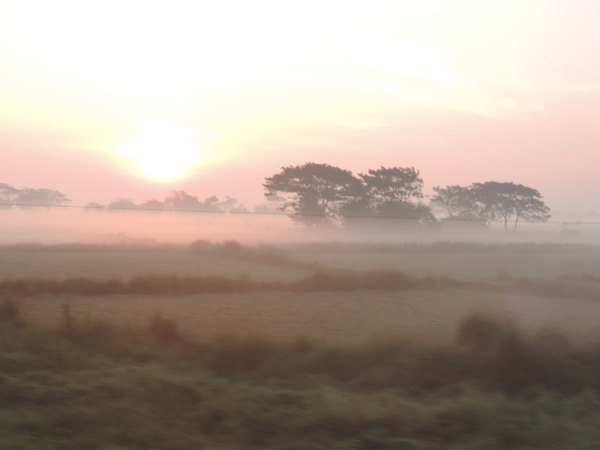 Sunrise as the train passed through rural countryside