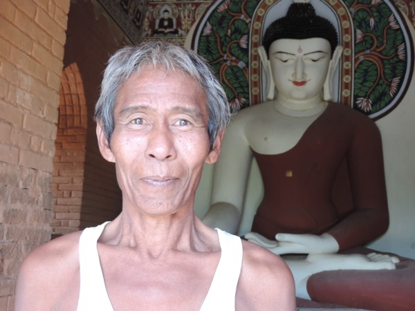 We met this lovely man who lived by one of the temples. He eagerly showed us his art-work - the Buddha!