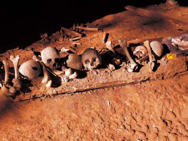 Human remains piled up in a cave