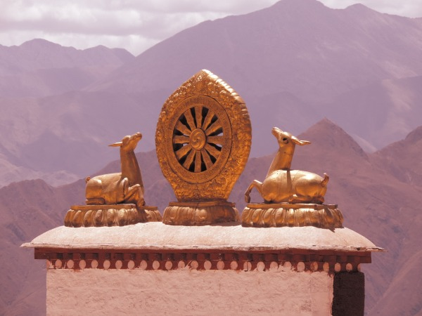 The iconic image of Golden Deer either side of the Dharmic Wheel